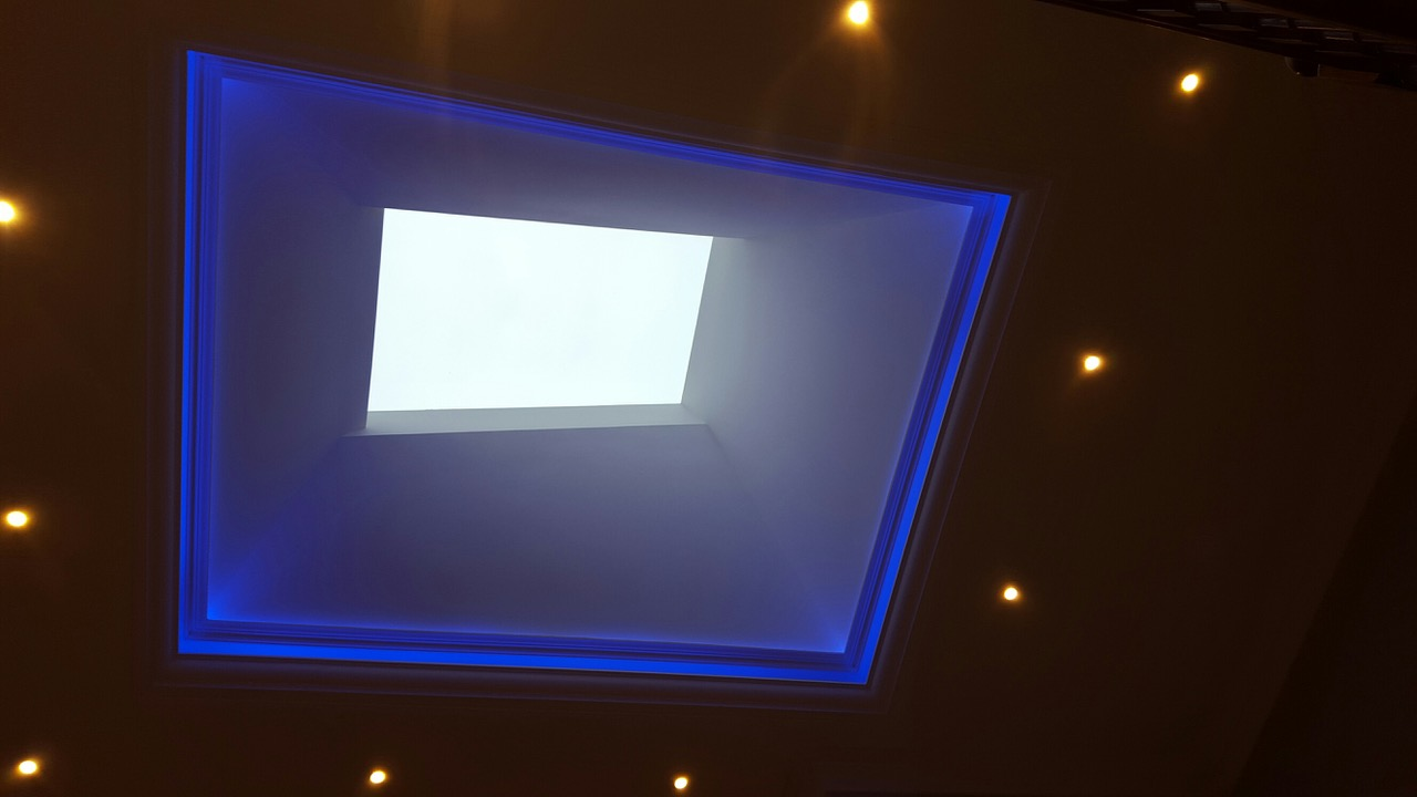 skylight lighting. this lighting changes colours by remote control seen here with blue light creates a very dramatic effect in the customers foyer area skylight